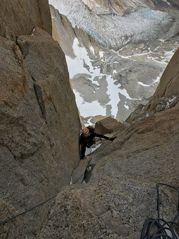 Anton Krupicka climbs a snowy dihedral on Guillaumet in Patagonia