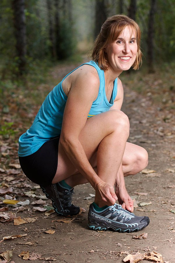 Pam Smith laces up her La Sportiva Ultra Raptor Mountain Running Shoes before a run